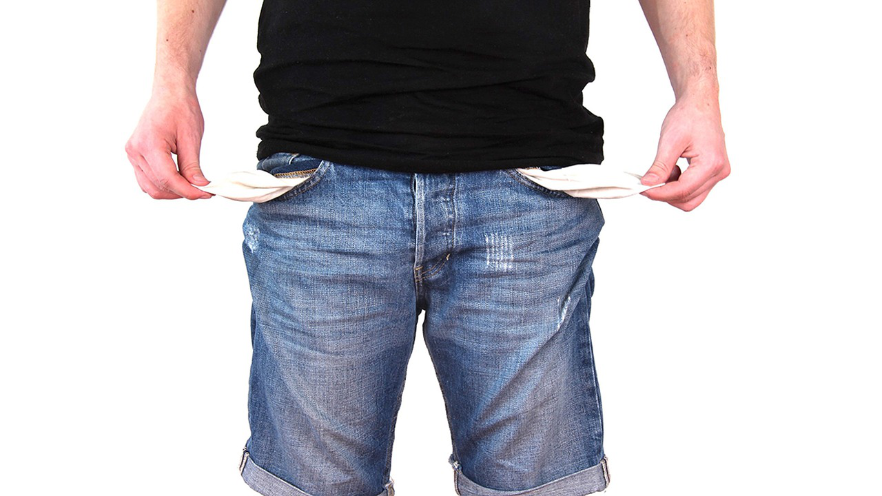 A person who has pulled their pockets out, suggesting that they have no money