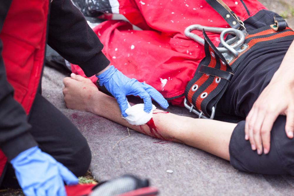A person with a bleeding workplace personal injury.
